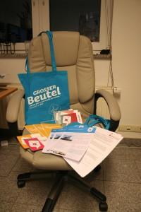 Welcome Package bestehend aus Stoffbeutel, Gutscheinen, Informationen zum Barcamp Erfurt und einem Schreibblock